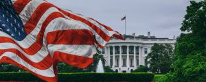 Photo of the American flag in front of the White House